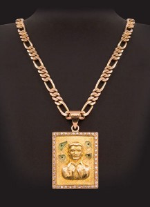 "Teresa Margolles, ""Score Settling 15,"" Jesús Malverde pendant inlaid with glass fragments from crime scene"